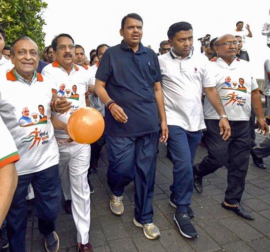 Maharashtra Chief Minister Devendra Fadnavis, Goa CM Pramod Sawant and other BJP leaders at the 'Mumbai Chalali BJP Sobat (Mumbai walks with BJP)' event in Mumbai, Sunday, Oct. 13, 2019. (PTI Photo)
