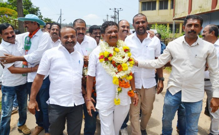Winning candidate K G Bopaiah from BJP being greeted by the partyworkers in Madikeri on Tuesday.
