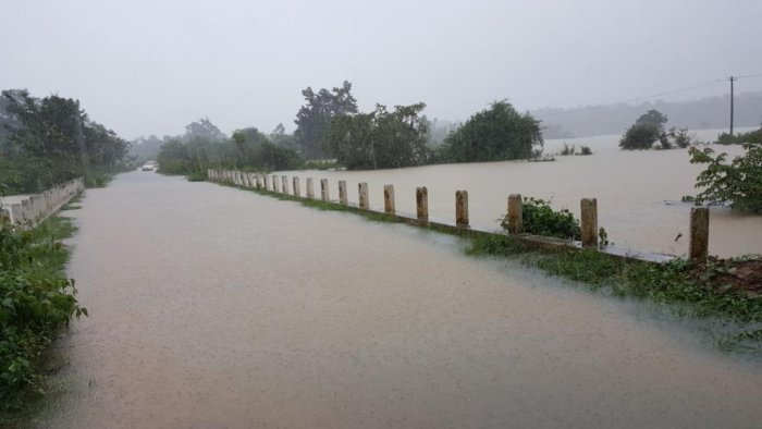 A view of inundated Kottageri-Balele bridge with water from Lakshamanatheertha river overflowing.