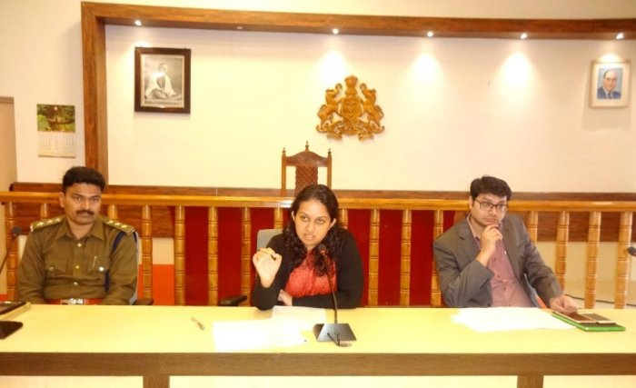 Deputy Commissioner P I Srividya speaks at a meeting on rain relief measures, in Madikeri, on Monday.