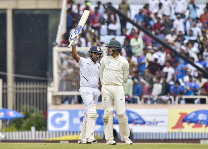 Indian cricketer Rohit Sharma celebrates after scoring 100 runs during the 3rd Test match between India and South Africa at JSCA Stadium in Ranchi. PTI