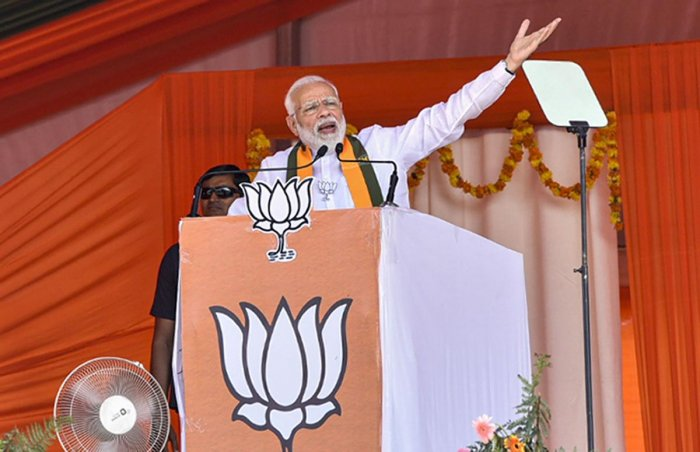 Prime Minister Narendra Modi gestures as he speaks during an election campaign rally ahead of Assembly polls in Sirsa district of Haryana. PTI