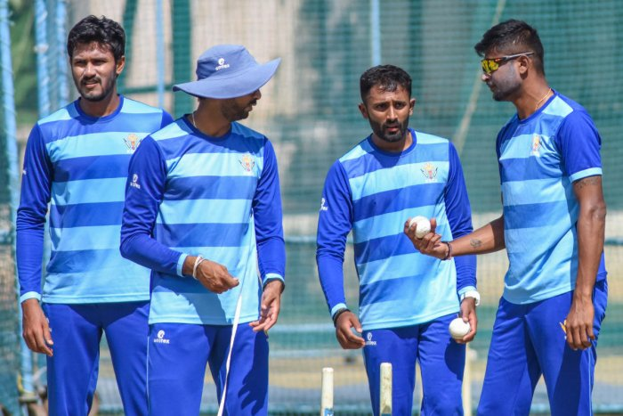 Karnataka pacer V Koushik, bowling coach S Arvind, spinners Shreyas Gopal and K Gowtham(from left) at a practice session in Bengaluru on Saturday. DH PHOTO/ S K DINESH
