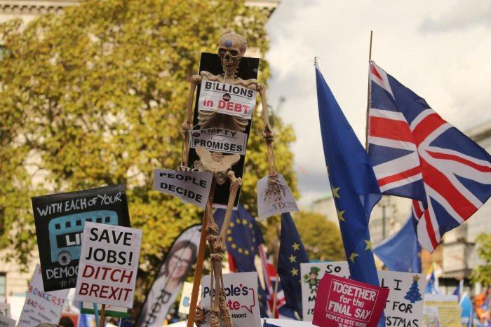 "Demonstrators with placards and EU and Union flags gather in Parliament Square in central London on October 19, 2019, as they take part in a rally by the People's Vote organisation calling for a final say in a second referendum on Brexit. - Thousands of people march to parliament calling for a ""People's Vote"", with an option to reverse Brexit as MPs hold a debate on Prime Minister Boris Johnson's Brexit deal. AFP"