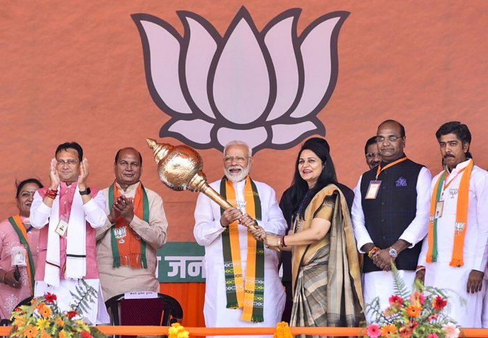 Prime Minister Narendra Modi being presented a mace during an election campaign rally ahead of Assembly polls in Haryana. PTI