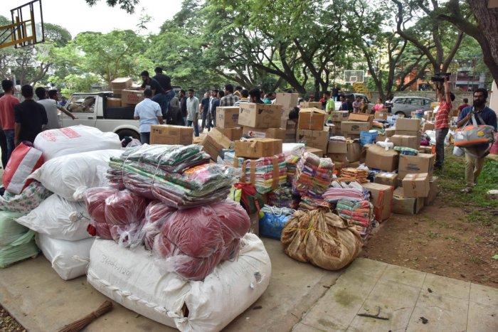 Volunteers sorting out relief material at the Kodava Samaja in Bengaluru on Saturday. DH Photo/Janardhan B K