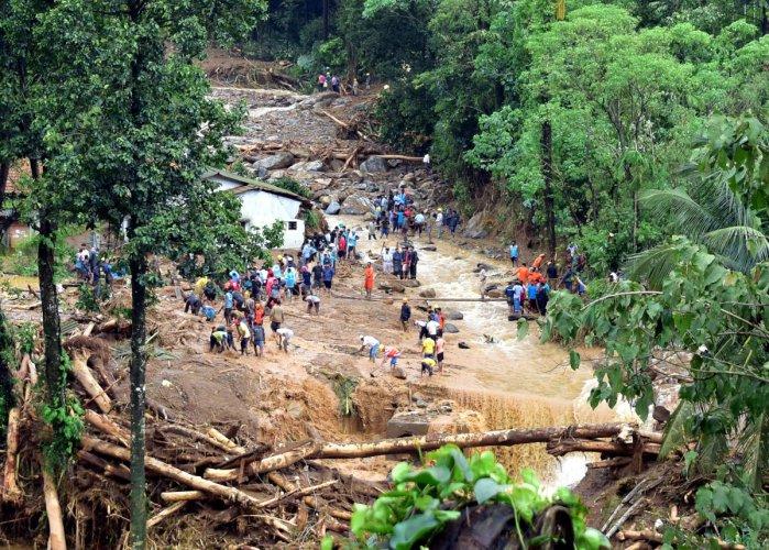The rescue operations underway at Jodupala near Madikeri on Saturday. DH PHOTO/Govindraj Javali