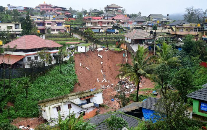 A concrete house has slipped after mud caved in following heavy rain in Madikeri. DH PHOTO