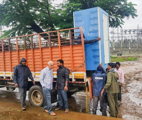 BBMP workers transporting mobile toilets to the flood-hit Kodagu district on Sunday.