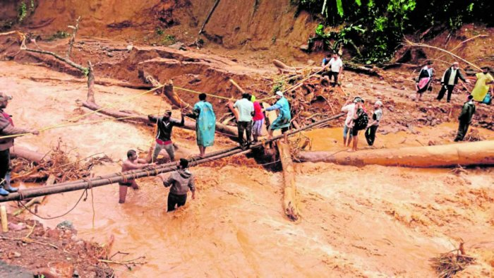 Victims being rescued using a makeshift bridge from the hilly ranges in Kodagu district.