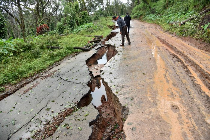 A view of damaged road near Madikeri. Over 5,500 houses have been destroyed and 2,000 km of roads damaged due to the rains in Kodagu and adjoining areas, as per initial estimates. DH PHOTO