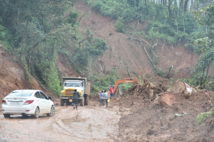 Reconstruction of a road at Thalathamane in Madikeri in full swing on Friday. DH Photo / B H Shivakumar