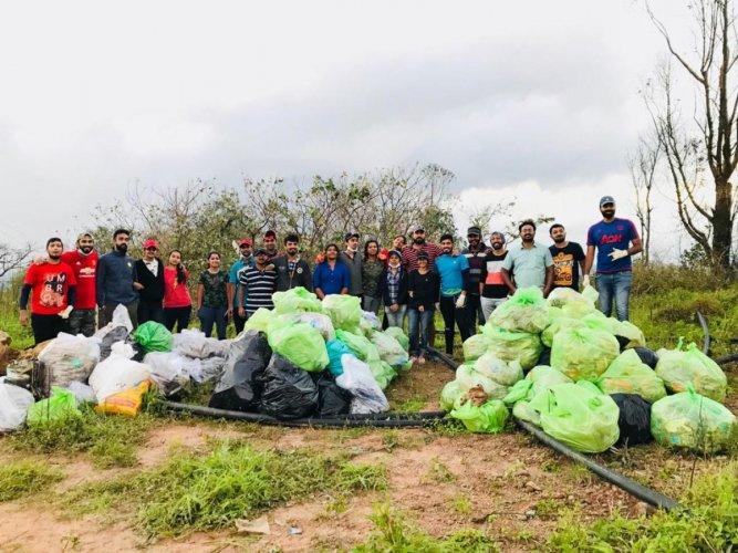 Bengaluru volunteers with waste collected from Kodagu.