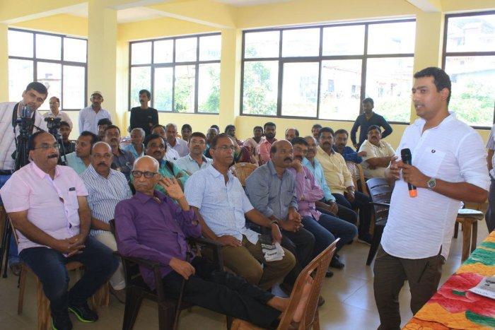 Geologist Aichettira Machaiah speaks at an interaction in Madikeri on Saturday.