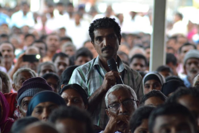 A flood victim speaks during an interaction with Chief Minister H D Kumaraswamy at Gandhi Maidan in Madikeri on Wednesday.