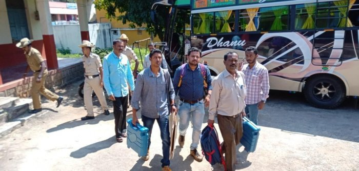 Polling staff leave for their respective polling booths in Kushalnagar on Saturday.