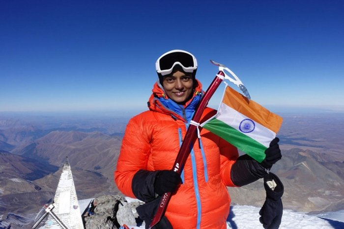 Mountaineer Bhavani waves the Indian national flag at the peak of Mount Elbrus in Russia.
