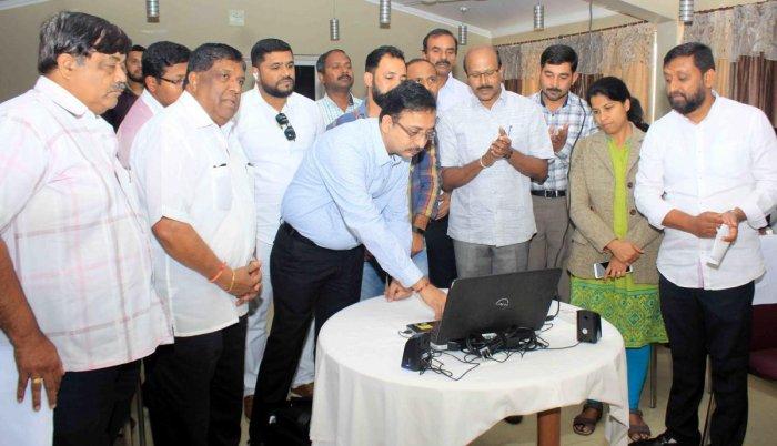 KSTDC MD Kumar Pushkar releases a short tilm on tourism in Madikeri. DH photo