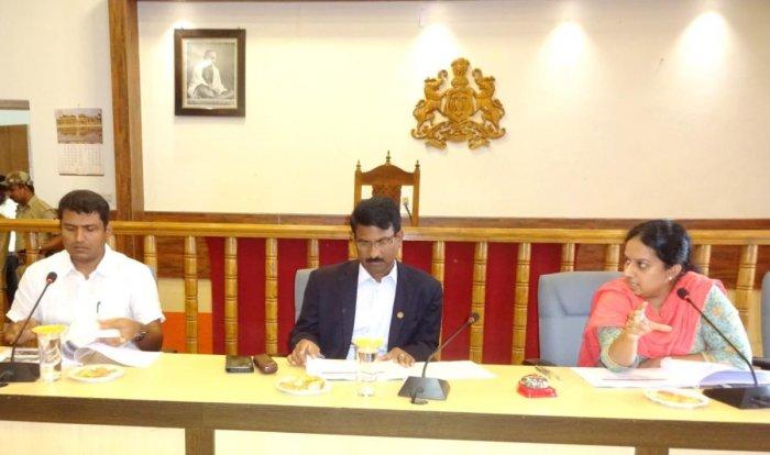 Lokayukta ADGP Murthy (centre) hairs a meeting at DC's office in Madikeri. DH photo