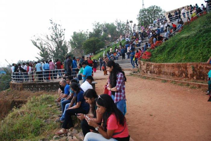 Tourists at Raja Seat in Madikeri.