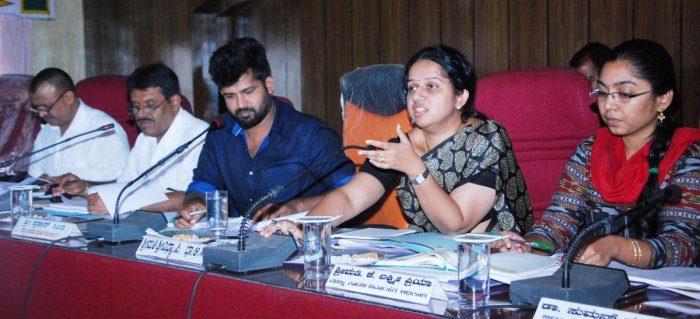 Deputy Commissioner P I Sreevidya speaks at the Development Coordination and Monitoring Committee (DISHA) meeting in Madikeri on Friday.