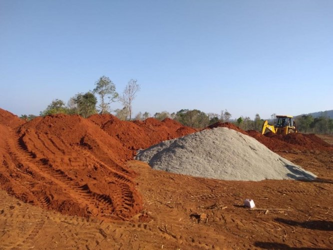 Piles of delay: One of the largest sites allocated for construction of new houses at Jambooru. The land, spread across 50 acres, is being levelled but construction work is yet to commence.DH Photo/Ambarish B