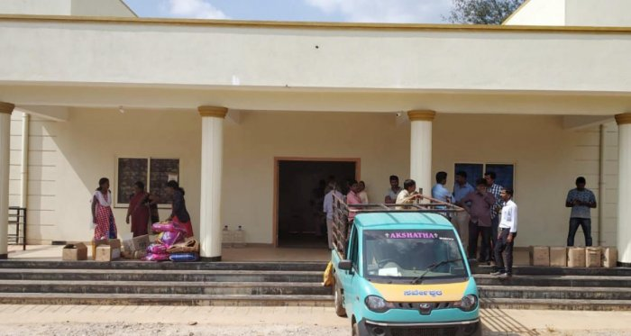 Awaiting distribution: A view of the Madikeri Junior College building where the relief materials have been stored. (Right) Rice stored in a godown.