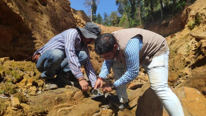 Scientists from the Geological Survey of India conduct a study at the site of a landslide in Kodagu.