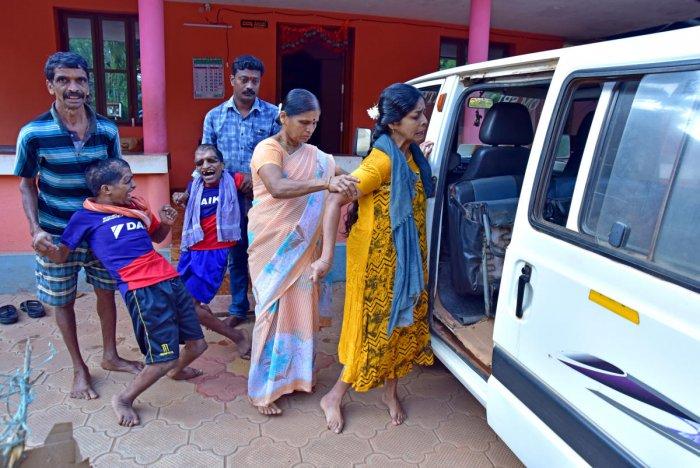 Rajeevi (in sari), with her three endosulfan-affected children, in Puttur taluk, Karnataka. Credit: DH Photo by Govindaraj Javali
