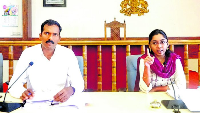 Zilla Panchayat CEO K Lakshmi Priya speaks during the meeting of election nodal officers at the DC's office hall on Monday. Kodagu Additional Deputy Commissioner T Yogesh looks on.