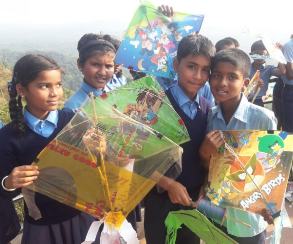 Children take part in a kite festival on the theme of voting in Madikeri.