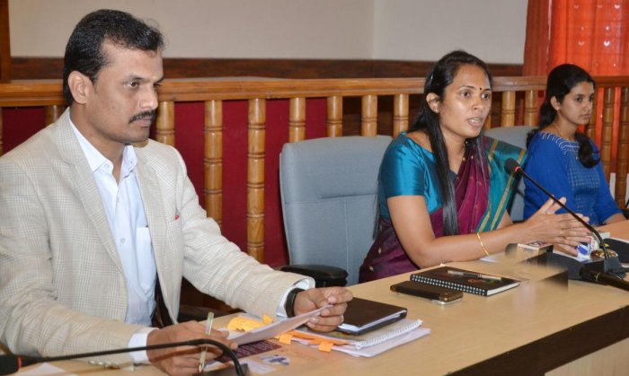 Deputy Commissioner Annies Kanmani Joy speaks to reporters in Madikeri on Tuesday. Additional Deputy Commissioner P Shivaraju and Tax Officer Shreya are seen. DH photo