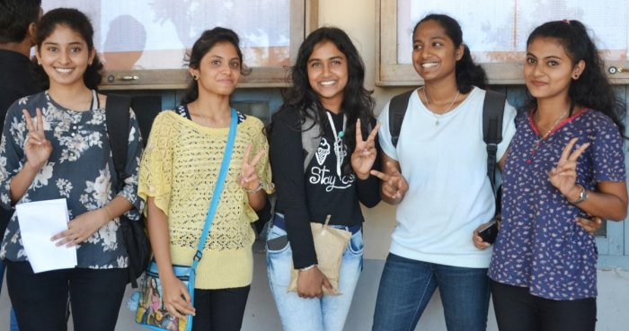 Students rejoice after checking their results in the II PU examinations in their college on Tuesday.