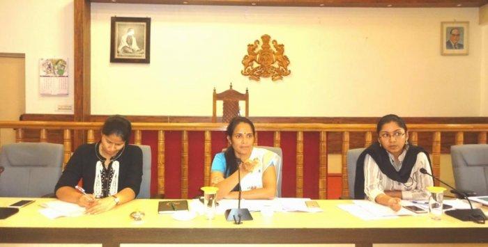 Deputy Commissioner Annies Kanmani Joy speaks at a meeting held in Madikeri on Tuesday. Superintendent of Police Dr Suman D Pennekar and Zilla Panchayat CEO K Lakshmi Priya look on.