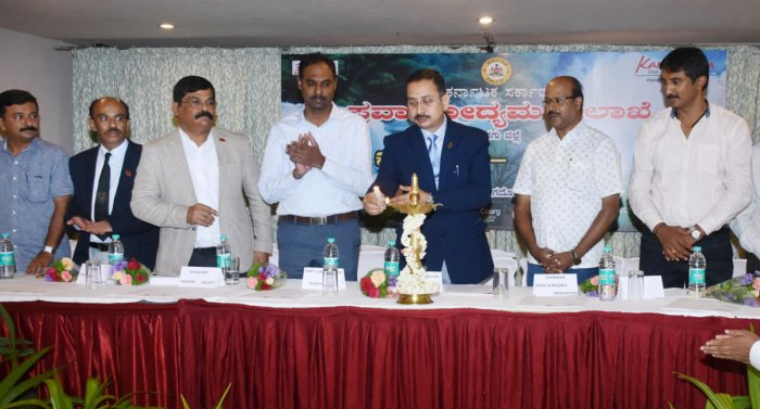 Karnataka State Tourism Development Corporation Managing Director Pushkar Kumar inaugurates, 'Connect', a preparatory meeting on tourism, in Madikeri on Friday.