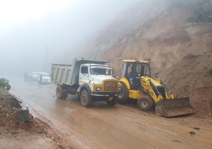 The debris near Karthoje, accumulated due to a landslide on Madikeri-Mangaluru National Highway, was cleared on Tuesday.