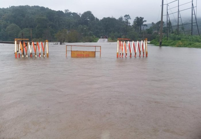 Bhagamandala-Napoklu Road is inundated following heavy rain in Kodagu district.