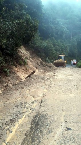 An earthmover pressed into service for clearing landslide on Charmadi Ghat, Chikkamagaluru district.