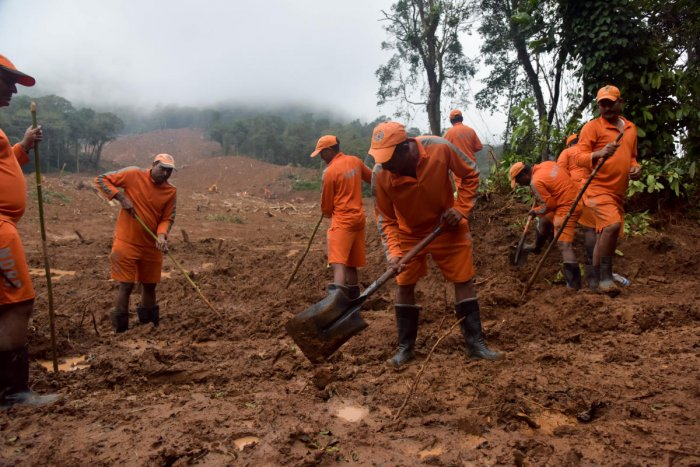 NDRF personnel look for bodies at the site of a landslide in Thora village, Virajpet taluk in Madikeri. Five people are still missing after the landslide. DH Photo/B H Shivakumar