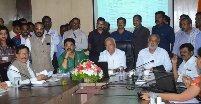 Chief Minister BSYediyurappa conducts a review meeting in Sainik School, Koodige, on Thursday. Revenue Minister R Ashoka, District In-charge and Primary and Secondary Education Minister Suresh Kumar, MLAsKGBopaiah and Appachu Ranjan look on.