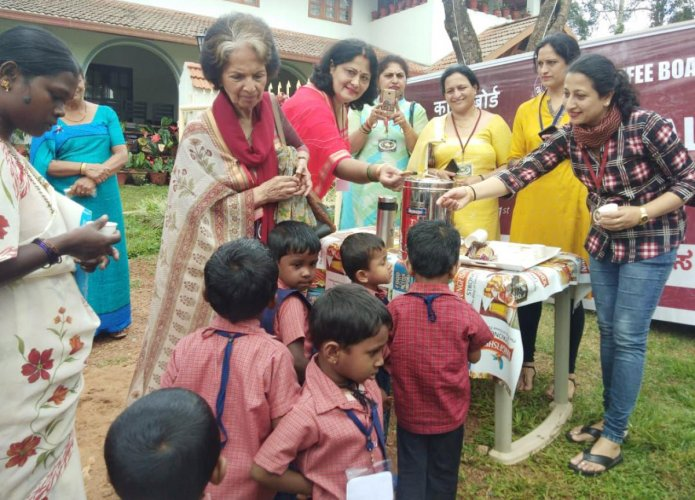 Coorg Coffee was distributed to people on International Coffee Day in Madikeri on Tuesday.
