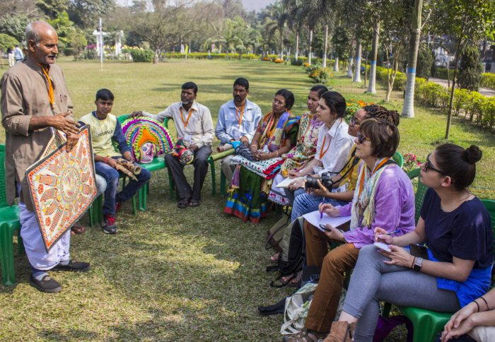 American participants learn about Indian folk art in a West Bengal craft village