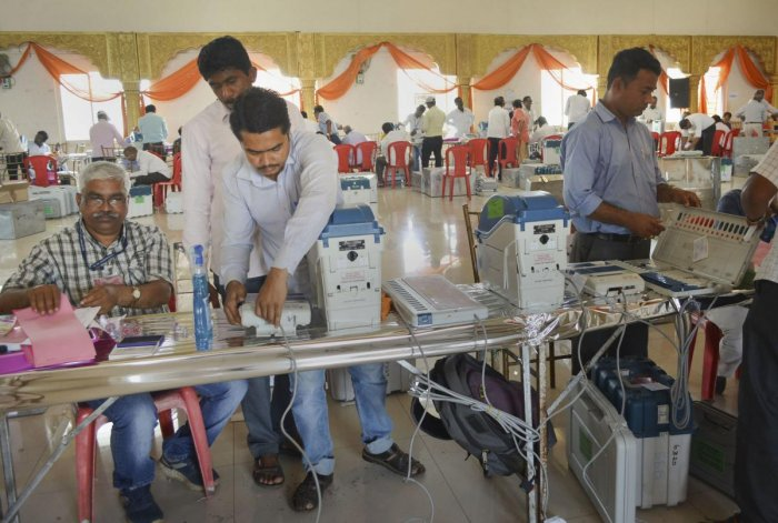 Polling officials check Electronic Voting Machines (EVM)'s and VVPAT's ahead of Maharashtra Assembly elections, in Karad, Maharashtra. (PTI Photo)