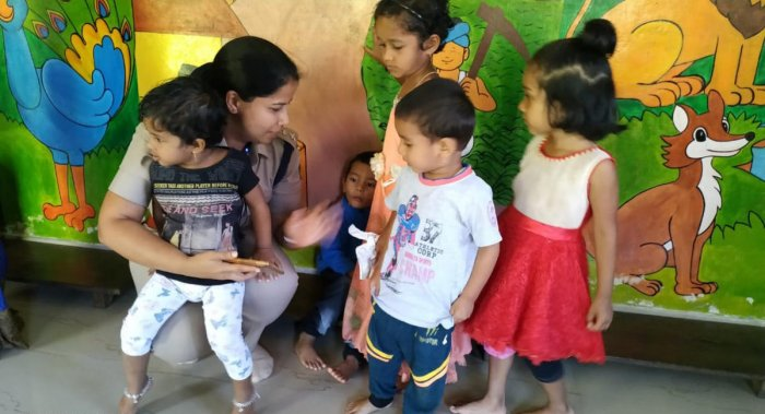 Kodagi Superintendent of Police Suman D Pennekar interacts with children at the anganwadi in Madikeri, where her child Khushi studies.