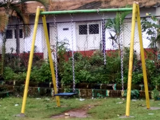 A broken swing at the park in front of N R Pura Town Panchayat.