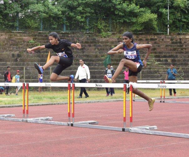 Athletes take part in hurdles at the Dakshina Kannada Junior Athletics meet at Mangala Stadium in Mangaluru on Saturday.