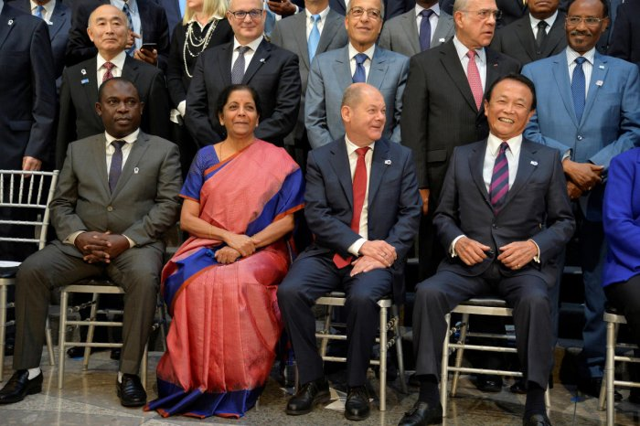 Cormoros' Finance Minister Said Ali Chayhane, India's Finance Minister Nirmala Sitharaman, Germany's Finance Minister Olaf Scholz and Japan's Finance Minister Taro Aso prepare for a group photo during the IMF and World Bank's 2019 Annual Meetings of finan