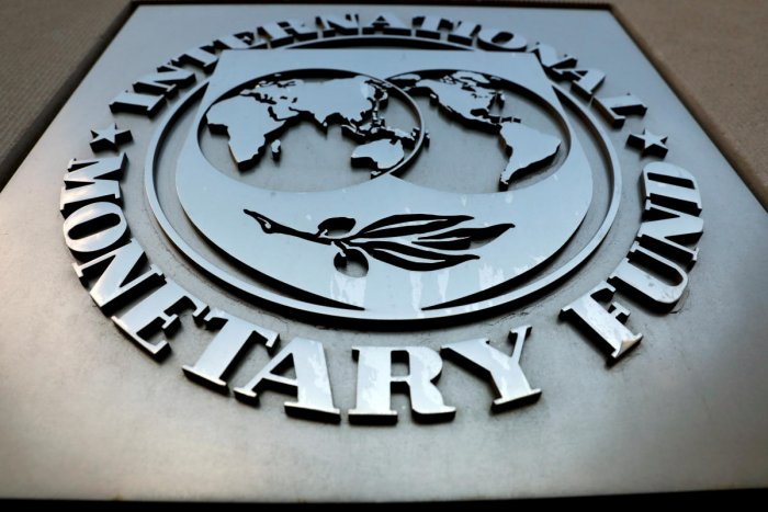 The IMF logo is seen outside the headquarters building in Washington (Photo by Reuters)