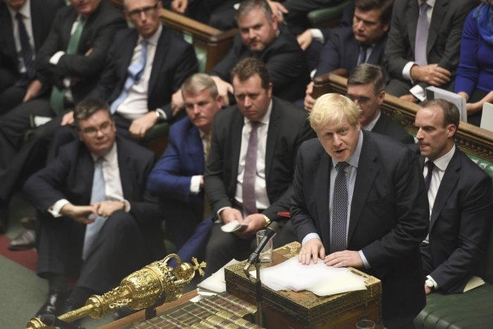 Boris Johnson speaks during the Brexit debate inside the House of Commons in London. At the rare weekend sitting of Parliament, Johnson implored legislators to ratify the Brexit deal he struck this week with the other 27 EU leaders. Lawmakers voted Saturd
