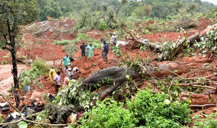 People searching the site of a landslide at Hatti Hole in Kodagu  district where a body was found on Wednesday. DH PHOTO/B H SHIVAKUMAR